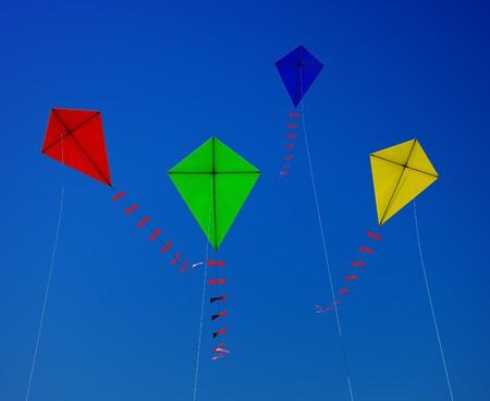 flying kite: A kite flying in the blue sky Stock Photo