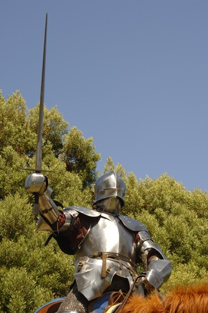 mediaeval: 15th Century English knight in shining armour in a charge position on horseback Stock Photo