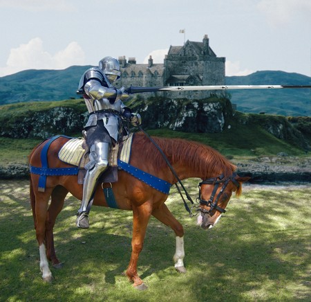 Knight in shining armour on his horse holding a lance  photo