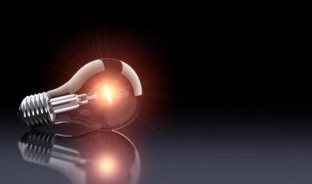bombilla: Una composici�n de alto contraste de un ightbulb sobre un fondo oscuro suave. Proyecto creado mediante aplicaciones 3d.  Foto de archivo