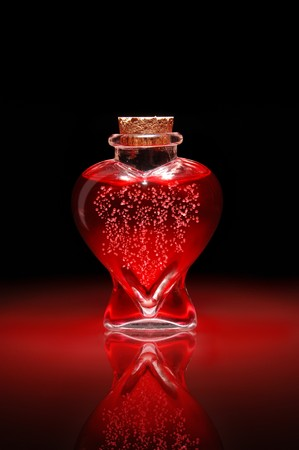 infatuation: Bottle of love potion shaped like a heart filled with bubbling red liquid