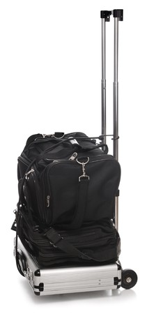 duffle: luggage stacked up on hand dolly ready to go Stock Photo