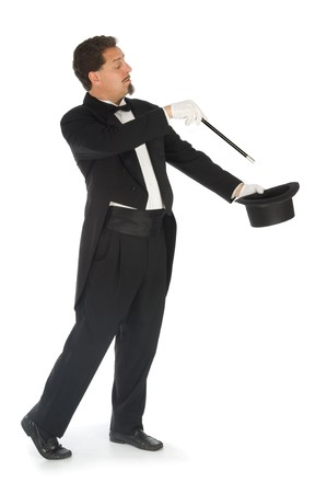 Professional magician wearing tuxedo performing on a white background photo