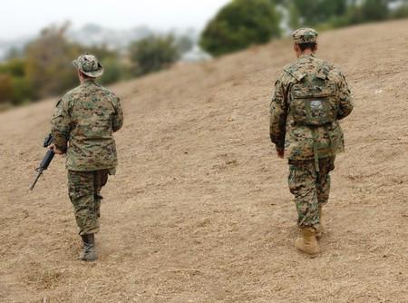 military draft: Two US Marines on patrol