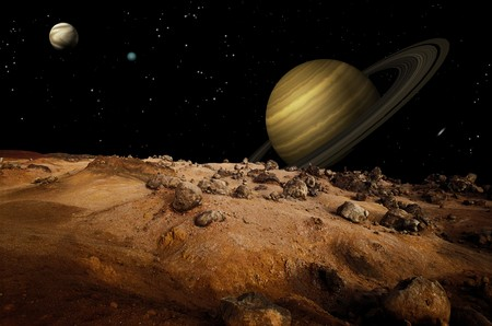 saturn: Outerspace shot from one of Saturns moons showing Saturn in the background