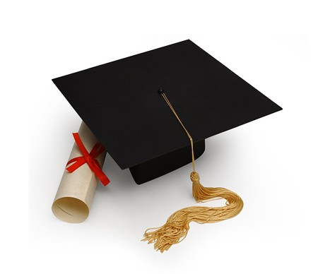 mortar board & diploma on white                                photo