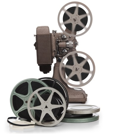 film editing: Movie film reels and vintage movie projector on white background