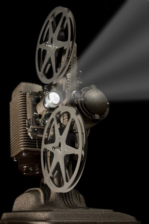 Worms eye view of a retro movie projector on a black background
