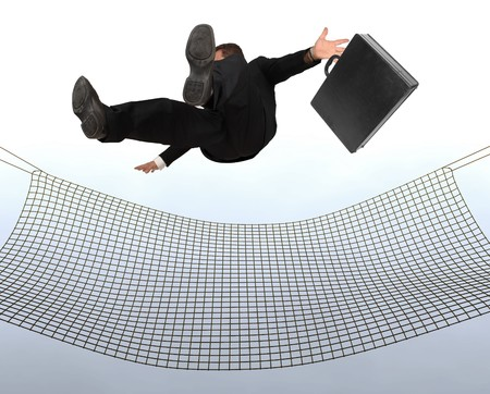 liability insurance: Businessman falling the Sky into a safty net