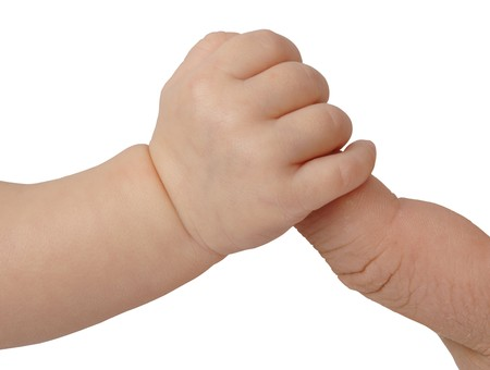 Hand of new born baby holding fathers finger on white background 版權商用圖片