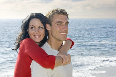 Young, attractive couple near the ocean photo