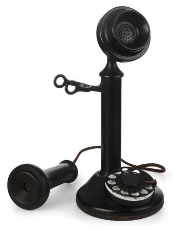 old technology: candeliere antico telefono con ricevitore il gancio su sfondo bianco