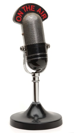 old broadcast microphone on white background photo