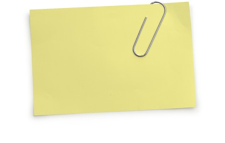 Paper clip holding a yellow memo paper on a white background Imagens - 7049184