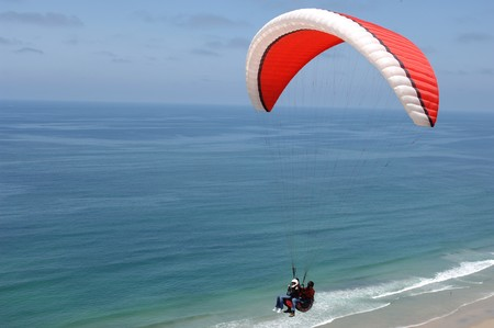 parasailing: Two people parasailing tandem over the California Coast near San Diego