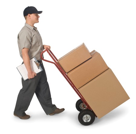 delivery service: Delivery man pushing hand truck with boxes, isolated on a white background  Stock Photo