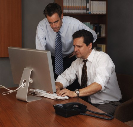 computer: two professional men working at the computer