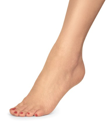 woman foot: female foot with red nail polish on white background