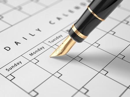 luxery: A luxery fountain pen wrighting in a calendar. Stock Photo