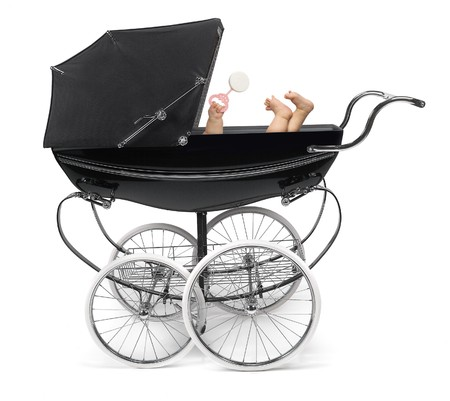 Profile of traditional baby strollerperambulator with baby arm and feet