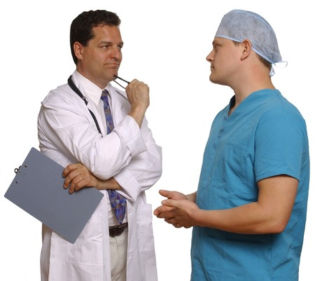 doctor and surgeon consulting on white background                                Stock Photo - 9519754
