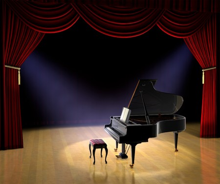 Piano on theatre stage with red curtain and spotlights on the stage floor
