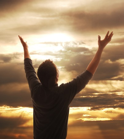 heaven: Man holding arms up in praise against golden sunset