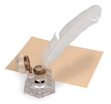 Vintage quill pen, parchment paper and ink well isolated on white Stock Photo - 7049655