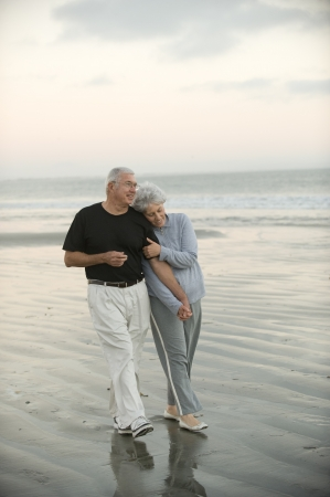 Senior couple walking the beach