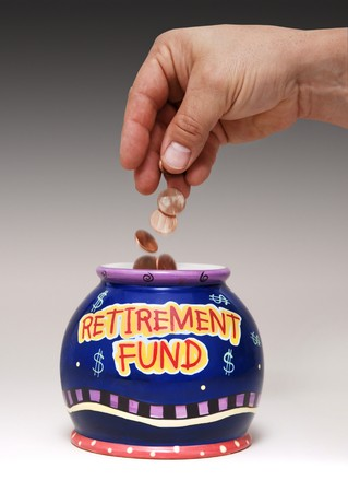 pension fund: hand dropping pennies into a jar labeled Retirement Fund