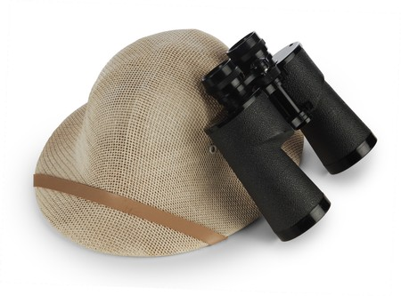 safari pith helmet and binoculars isolated on white background