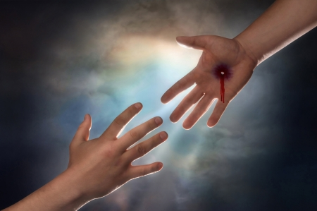 immortality: Hand of Christ reaching down from heaven to grab the hand of man