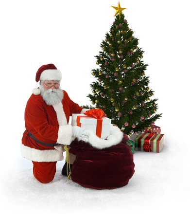 Santa next to a Christmas tree  unloading presentsfrom his sack of gifts on a white background Stock Photo - 9519902