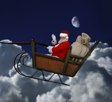Santa in his sleigh flying throught a nighttime cloudscape