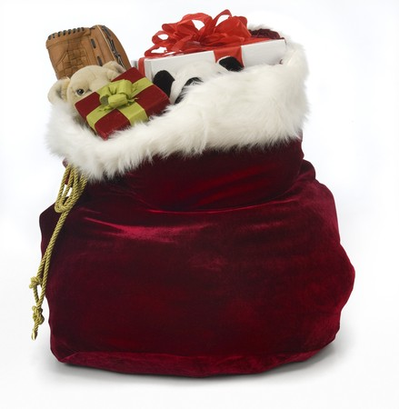sack: Santas sack filled with toys on a white background Stock Photo