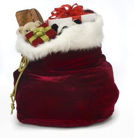 christmas toys: Santas sack filled with toys on a white background Stock Photo