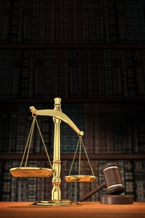 verdicts: Scales of justice and gavel on desk with dark background that allows for copyspace. Stock Photo