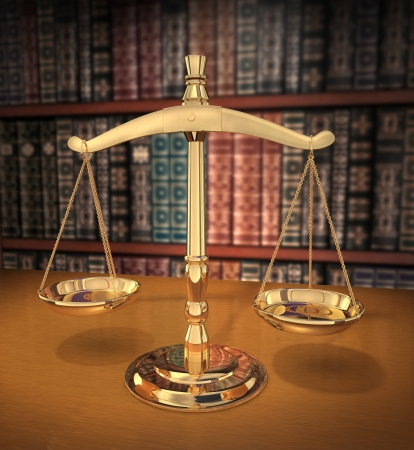 the litigation: Brass Scales of Justice on a desk showing Depth-of-field books behind in the background