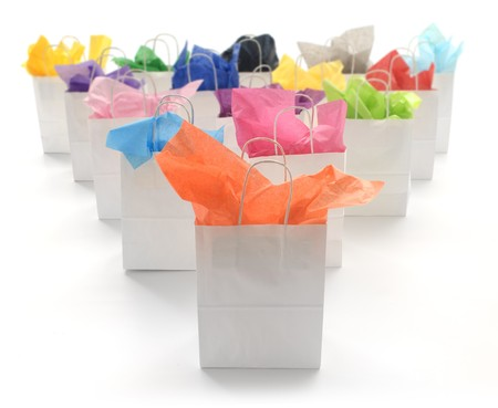 shopping bags: White shopping bags with brightly colored tissues on a white background