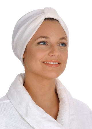 rejuvenated: isomorphic view of a beautiful young woman in white terry cloth bathrobe and turban looking clean, fresh and pampered on white background