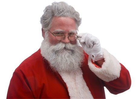 st  nick: Santa looking over the top of his glasses against a white background