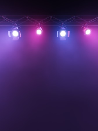 stage spotlight: A Stage Light Rack with 3  Colored Spotlights Shining down towards the middle of the layout in a dark area. Stock Photo
