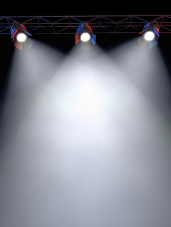 A Stage Light Rack with 3 Spotlights Shining down towards the middle of the layout in a dark area. Stock Photo - 7053864