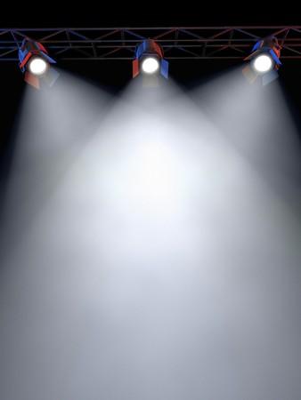 strata: Un rack di luce stage con 3 faretti Shining gi� verso la met� del layout in una zona scura.  Archivio Fotografico