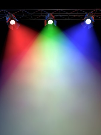 spotlight on stage: A Stage Light Rack with 3  Colored Spotlights Shining down towards the middle of the layout in a dark area. Stock Photo