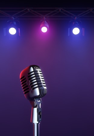 performing arts: 50s mic over stage light background.
