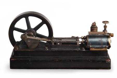 flywheel: vintage steam piston and flywheel Stock Photo