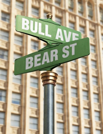 An old-Fashioned street sign for an intersection with street names that resemble the state of the coming market. photo