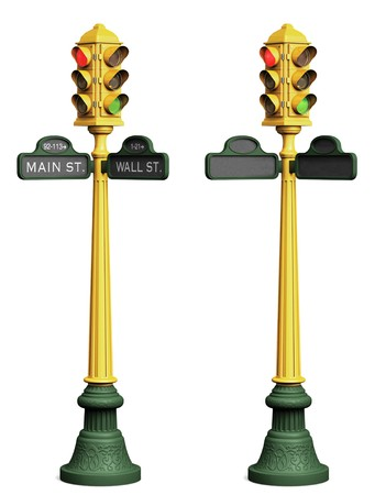 Two stop light posts on a white background; one with blank street signs, the other with Main St. and Wall St. shown photo