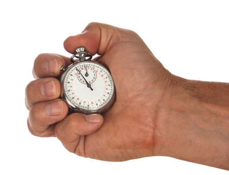 male hand holding stop watch